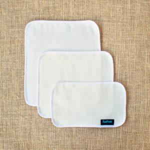 3 unfolded hemp fleece towel inserts showing the sizes Light, Medium and Heavy