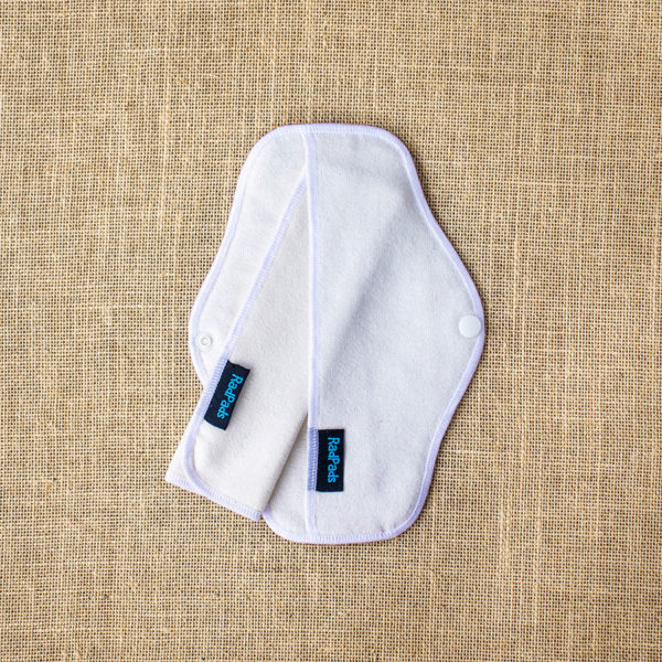 A natural hemp fleece reusable menstrual pad with a towel insert