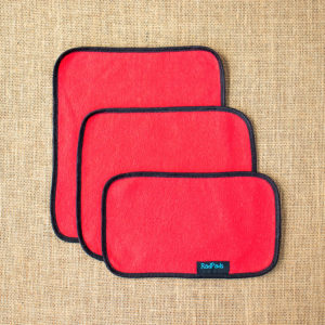 3 unfolded red hemp fleece towel inserts showing sizes Light, Medium and Heavy